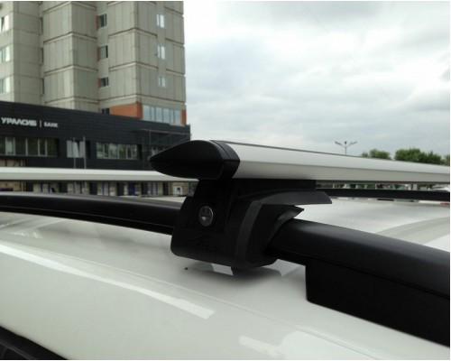 Багажник Люкс Элегант с замками с крыловидными дугами на рейлинги