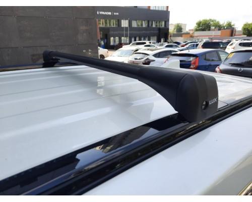 Багажник LUX Bridge аэро-трэвэл в штатные места на интегр. рейл. черный для Chevrolet Trailblazer II 2012-2016